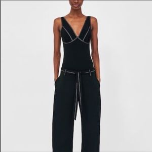 Black bodysuit with white contrast stitching